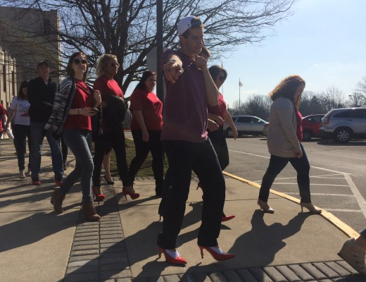 Sophomore Collin Anderson participated in Alpha Chi Omega's Walk a Mile in Her Shoes event last Saturday to raise awareness for domestic violence.