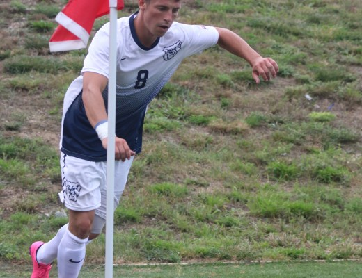 Jeff Adkins kicks a ball during the men's soccer team's scrimmage versus Notre Dame (photo by Jimmy Lafakis)