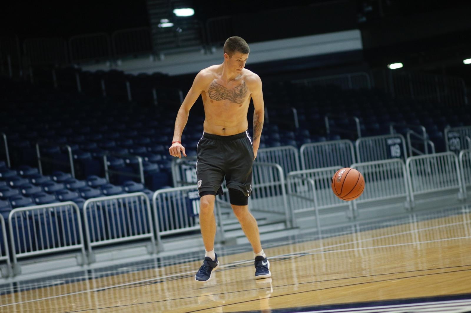 585db1b58 Butler basketball redshirt sophomore Sean McDermott dribbles the ball in  open gym at Hinkle Fieldhouse. McDermott has gotten three tattoos since  entering ...